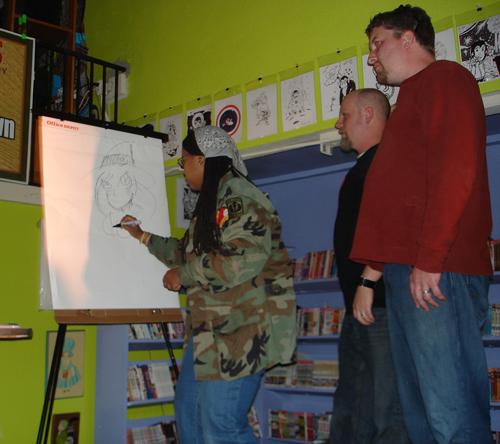 """Templar, Arizona"" creator Spike is the Queen of the Comic Art Battle. Teammates Ryan Dunlavey (""Action Philosophers"") and Kevin Moore (""Wanderlost"") look on."